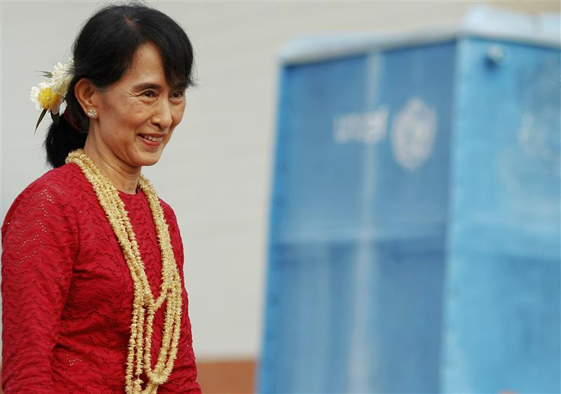 Aung San Suu Kyi smiles as she visits a polling station.